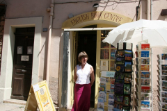 Jill manning the shop doorway
